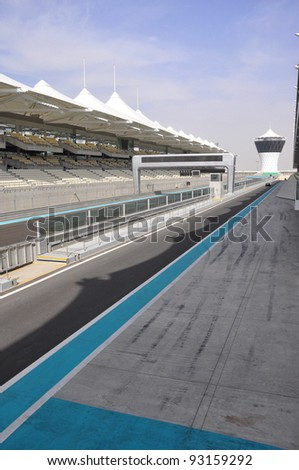ABU DHABI, UAE - MARCH 7: The Yas Marina Grand Prix Circuit on March 7. 2011 in Abu Dhabi. The Formula 1 racetrack has on 161.9 ha area 5.5 km length, 41093 seating capacity. Opened October 2009 - stock photo