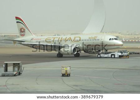 ABU DHABI, UAE - MARCH 10, 2015: Towing aircraft Airbus A320-232 (A6-EIR) Etihad Airways in Abu Dhabi - stock photo