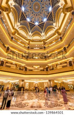 ABU DHABI, UAE - MAY 1: Emirates Palace hotel on May 1, 2013. Emirates Palace is a luxurious and the most expensive 7 star hotel designed by renowned architect, John Elliott RIBA. - stock photo