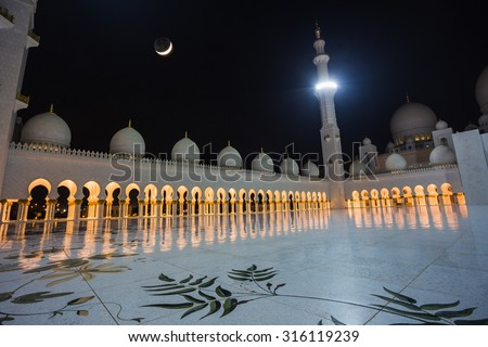 ABU DHABI, UAE - NOV 5: The Shaikh Zayed Mosque on the November 5, 2013 in Abu Dhabi, This is largest mosque in UAE white marbel - stock photo