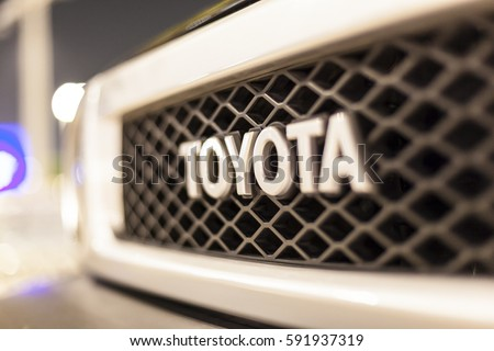 ABU DHABI, UAE - NOV 26, 2016: Toyota company logo on a car illuminated at night