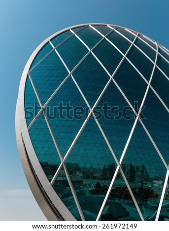 ABU DHABI, UAE - NOVEMBER 5: Aldar headquarters building is the first circular building of its kind in the Middle East on November 5, 2013 in Abu Dhabi, UAE - stock photo