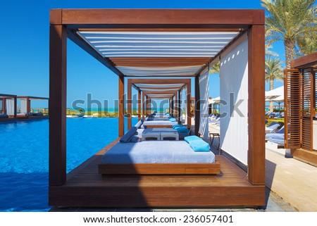 ABU DHABI, UAE - NOVEMBER 29. Swimming pool of the luxury hotel, Saadiyat island, taken on 29 November 2014 in Abu Dhabi, UAE  - stock photo