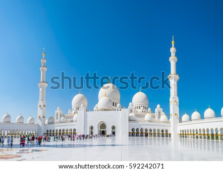 ABU DHABI, UAE, OCTOBER 29, 2016: Visitors are coming to the Sheikh Zayed Mosque, Abu Dhabi, United Arab Emirates