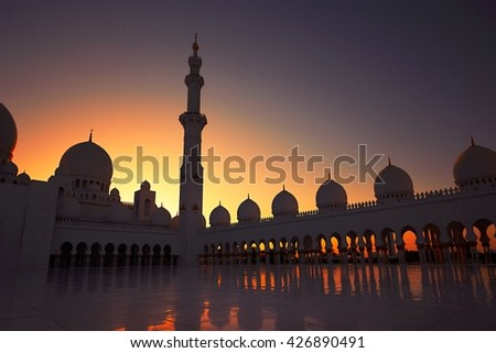 ABU DHABI, UNITED ARAB EMIRATES - April 19: Court yard and minaret of the Sheikh Zayed Grand Mosque on April 19 2016. This is the largest mosque in the United Arab Emirates.