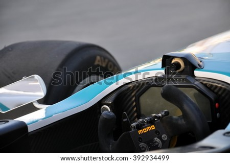 ABU DHABI, UNITED ARAB EMIRATES, NOVEMBER 3, 2013, Formula One Racing Event, Track, Close Up View of Driver Pilot Momo Branded Steering Wheel, Camera, Mirror, Wheel, F1 Car, Documentary Editorial