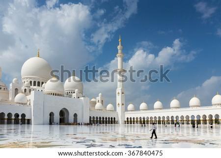 ABU DHABI, UNITED ARAB EMIRATES - NOVEMBER 5: Sheikh Zayed Grand Mosque November 5, 2013 in Abu Dhabi, United Arab Emirates. The famous Sheikh Zayed mosque is the largest mosque in UAE - stock photo