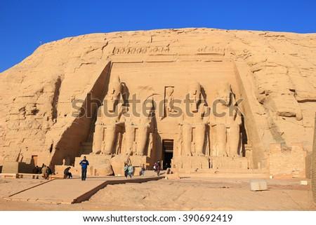ABU SIMBEL, EGYPT - FEBRUARY 3, 2016: Entrance to Ramses II Sun Temple, Abu Simbel in Egypt in early morning light - stock photo