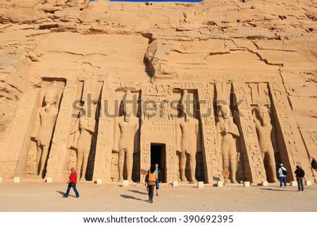 ABU SIMBEL, EGYPT - FEBRUARY 2, 2016:Tourists visit theTemple of Hathour built by  Ramses II dedicated to his wife, Nerfertari, Abu Simbel in Egypt - stock photo