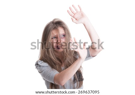 Abused and scared woman protecting herself isolated on white background - stock photo
