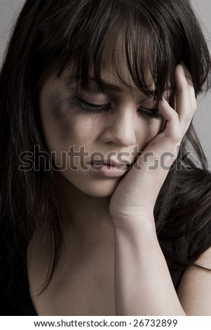 Abused woman crying holding her face - stock photo
