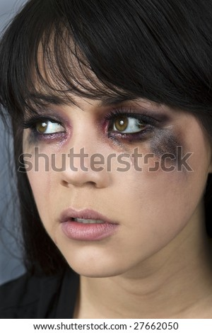 Abused woman crying with makeup smeared - stock photo