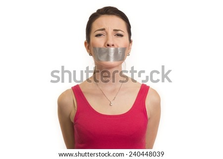 abused woman in red with adhesive gaffer tape on her mouth experiencing emotional pain isolated - stock photo