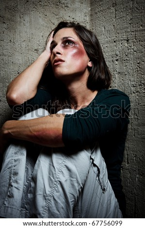 Abused woman wondering why her loved one would hurt her in this way - stock photo