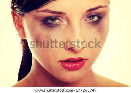 Abused young woman over white background
