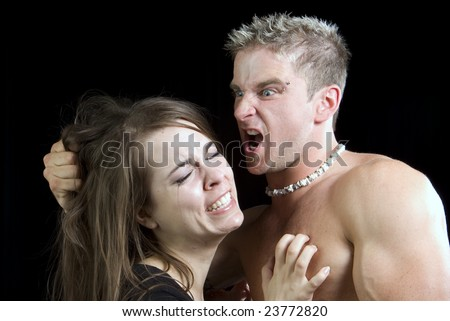 abusive violent man threatening his wife or girlfriend