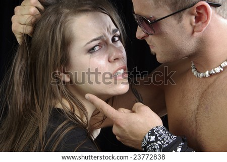 abusive violent man threatening his wife or girlfriend - stock photo