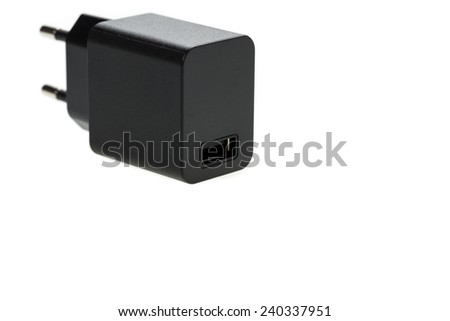 AC-DC power supply adapter with USB connector on white background - stock photo