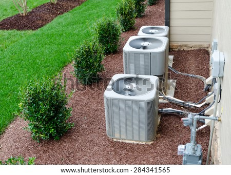 AC units connected to the residential house  - stock photo