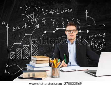 Academic. Young teacher sitting in school classroom - stock photo