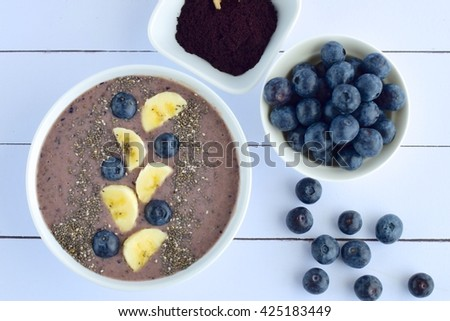 Acai berry smoothie bowl with banana, blueberry and chia seeds - stock photo