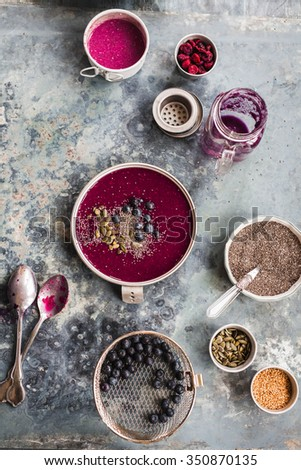 Acai Breakfast Smoothies bowl. overhead with sliced of fruit and seeds considered a superfood containing protein, omega fat, minerals, antioxidants. Top view. - stock photo