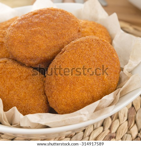 Acaraje - Traditional Brazilian fritters made with black-eyed peas and onions deep fried in palm oil (dende). Typical food from Bahia. Close up. - stock photo