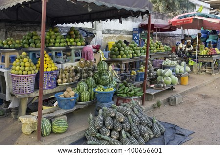 ACCARA, GHANA - JANUARY 22, 2016: Retail trade in fruit and vegetables on one of streets of the capital of Ghana. As sellers only women work generally - stock photo