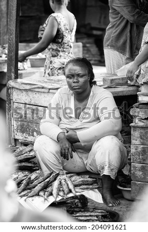 ACCARA, GHANA - MAR 4, 2012: Unidentified Ghanaian woman portrait in black and white. People of Ghana suffer of poverty due to the unstable economical situation