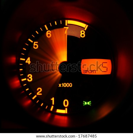 Accelerating sport-car tachometer closeup - stock photo