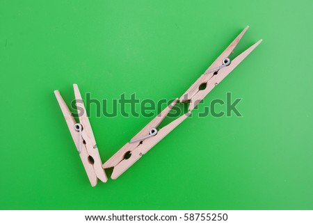 Acceptance sign made of wooden clothes pegs on a green background. - stock photo