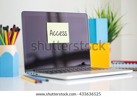 Access sticky note pasted on the laptop - stock photo