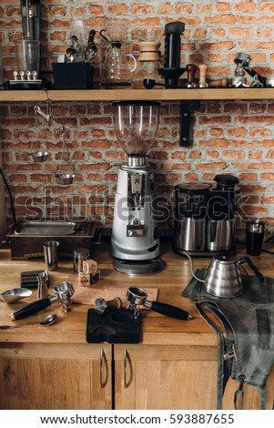 Accessories and items for coffee on a background of a brick wall. School barista. Equipment for cafes.
