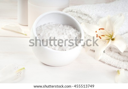 Accessories for bath (bath salt, towels, shampoo) decorated with  lily