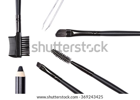 Accessories for care of the brows: eyebrow pencil, angle brushes made from natural bristles, spooly brush, tweezers and brow comb / brush combo on white background. Eyebrow grooming tools - stock photo