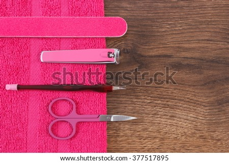Accessories for manicure or pedicure, nail file, scissors, nail clippers, fluffy towel, concept of nail care, copy space for text - stock photo