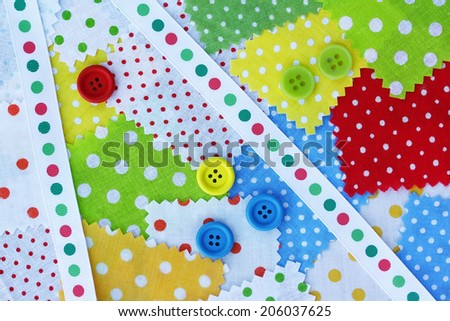 Accessories for needlework: fabric, band, buttons of yellow, green, red, blue color - stock photo