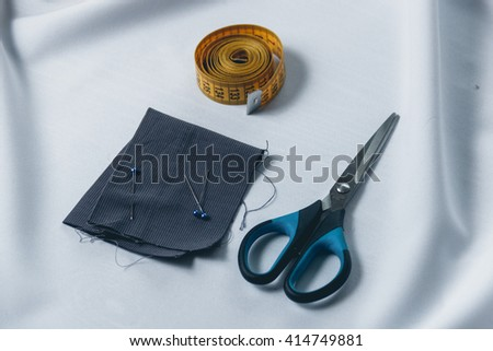 Accessories for needlework on white cloth background - stock photo