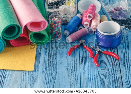 Accessories for needlework on wooden background. Set for needlework top view - stock photo