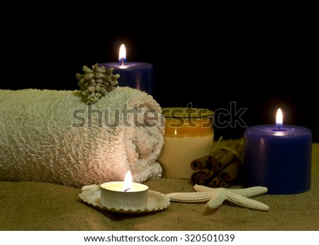 Accessories for spa treatments in the candlelight - stock photo
