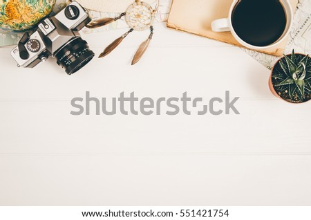 accessories for travel top view on wooden background with copy space adventure and wanderlust concept