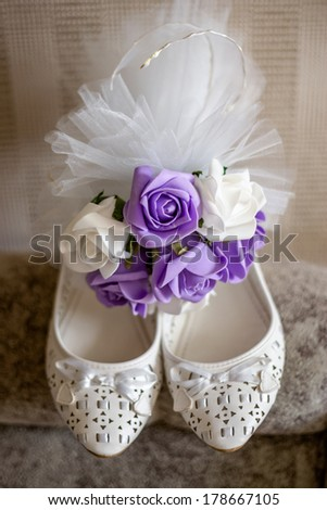 Accessories for wedding day: wedding shoes, bouquet. - stock photo