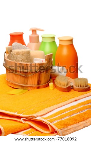 Accessories to a sauna- soft towels, gel, shampoo, wooden bucket, brush, tooth-brush, sponge and pumice - stock photo