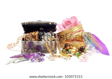 Accessory and gold jewelry in silver jewel chest, over white - stock photo