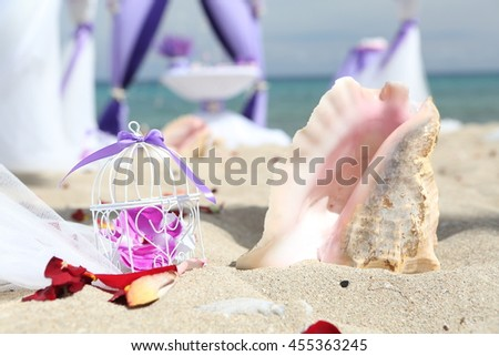 Accessory kit for a wedding is on the shores of the Caribbean Sea. - stock photo