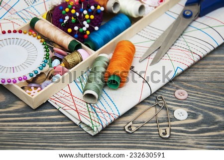 Accessory of the tailor - sewing background - stock photo