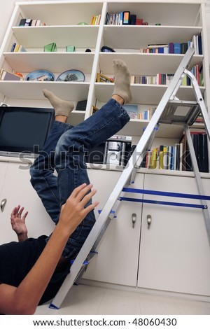 accident at home: man has falling from ladder - stock photo