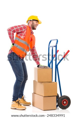 Accident at work. Manual worker holding lower back in pain. Full length studio shot isolated on white.. Full length studio shot isolated on white. - stock photo