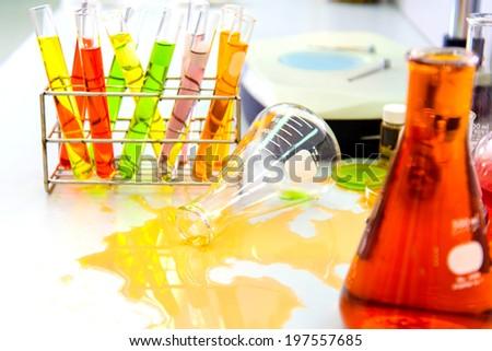 Accident in laboratory test, toxic splash - stock photo