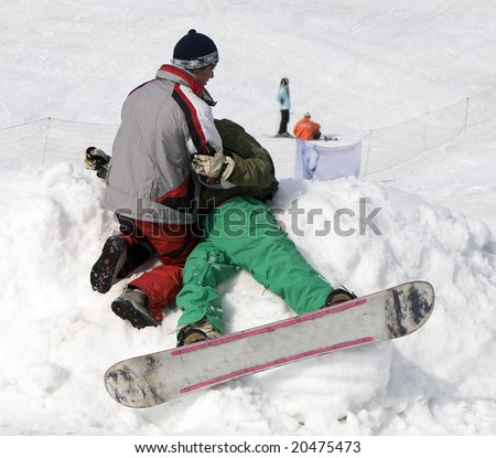 Accident with athlete snowboarder at winter contest in mountains Tien Shan - stock photo